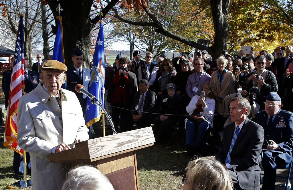 . Richard Cole, left, one of the four surviving members of the 1942 raid on Tokyo led by Lt. Col. Jimmy Doolittle, speaks for the other survivors during ceremonies honoring them, Saturday, Nov. 9, 2013, at the National Museum of the US Air Force in Dayton, Ohio. (AP Photo/Al Behrman)