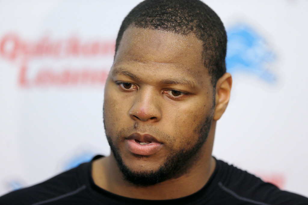 . Detroit Lions defensive tackle Ndamukong Suh addresses reporters after the team\'s organized team activities at the Lions NFL football training camp facility in Allen Park, Mich., Wednesday, May 21, 2014. Suh is expected to be at practice all this week after missing Detroit\'s voluntary minicamp last month. (AP Photo/Carlos Osorio)