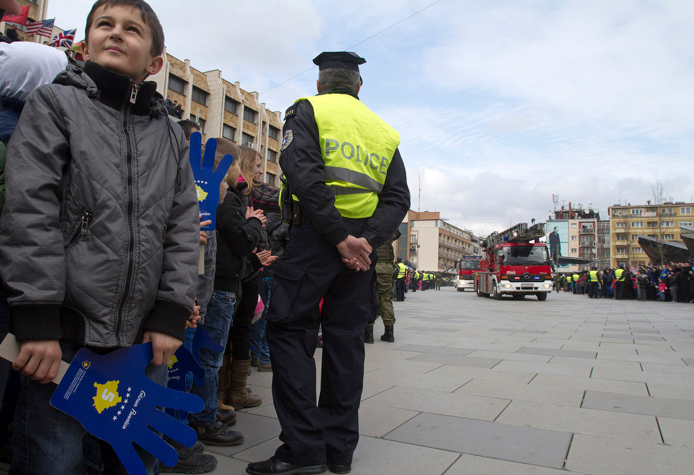 . Kosovo Albanian children watch Kosovo Security Force members and emergency services parade in the center of Pristina marking the 5th anniversary since Kosovo seceded from Serbia on Sunday, Feb. 17, 2013. Serbia rejects Kosovo\'s independence. (AP Photo/Visar Kryeziu)