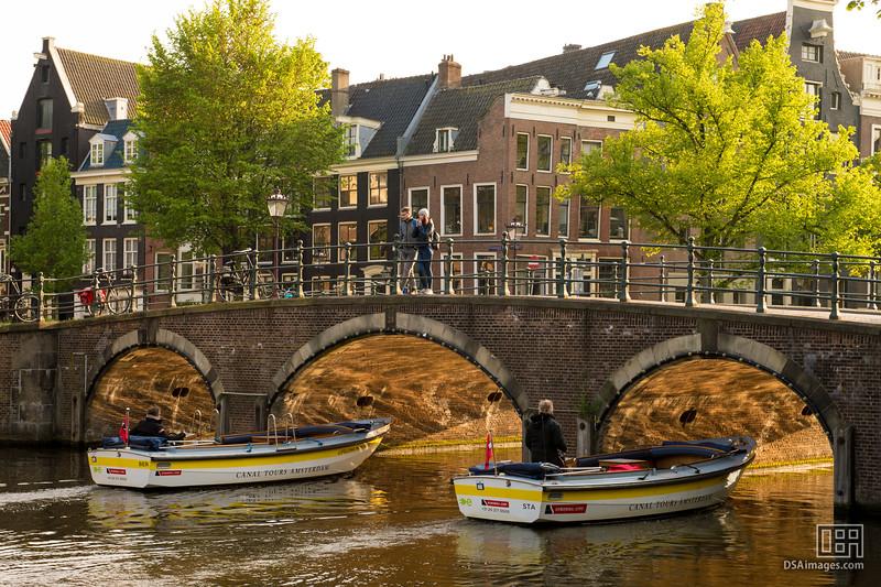Sunlit arches of a canal bridge