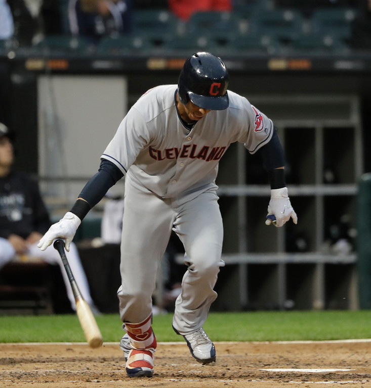 . Cleveland Indians\' Michael Brantley slams his bat down after popping up to end the top half of the third inning of a baseball game against the Chicago White Sox Monday, June 11, 2018, in Chicago. (AP Photo/Charles Rex Arbogast)