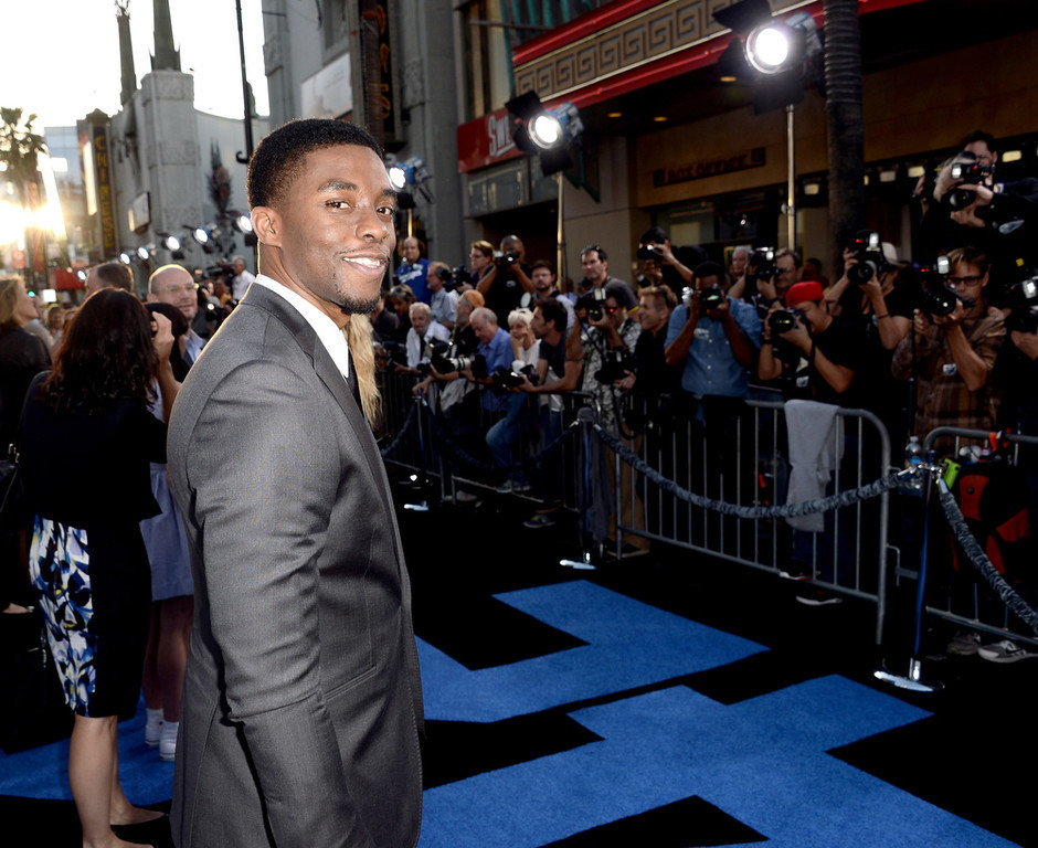 """. Actor Chadwick Boseman arrives at the premiere of Warner Bros. Pictures\' and Legendary Pictures\' \""""42\"""" at the Chinese Theatre on April 9, 2013 in Los Angeles, California.  (Photo by Kevin Winter/Getty Images)"""