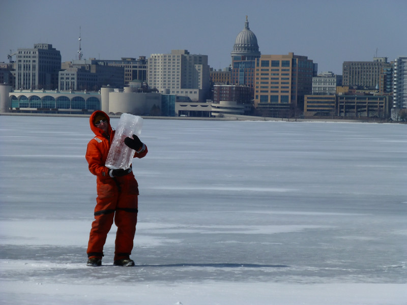 Ted Bier hoists a two-foot thick chunk of ice on Lake Monona.  Photo: Dave Harring.
