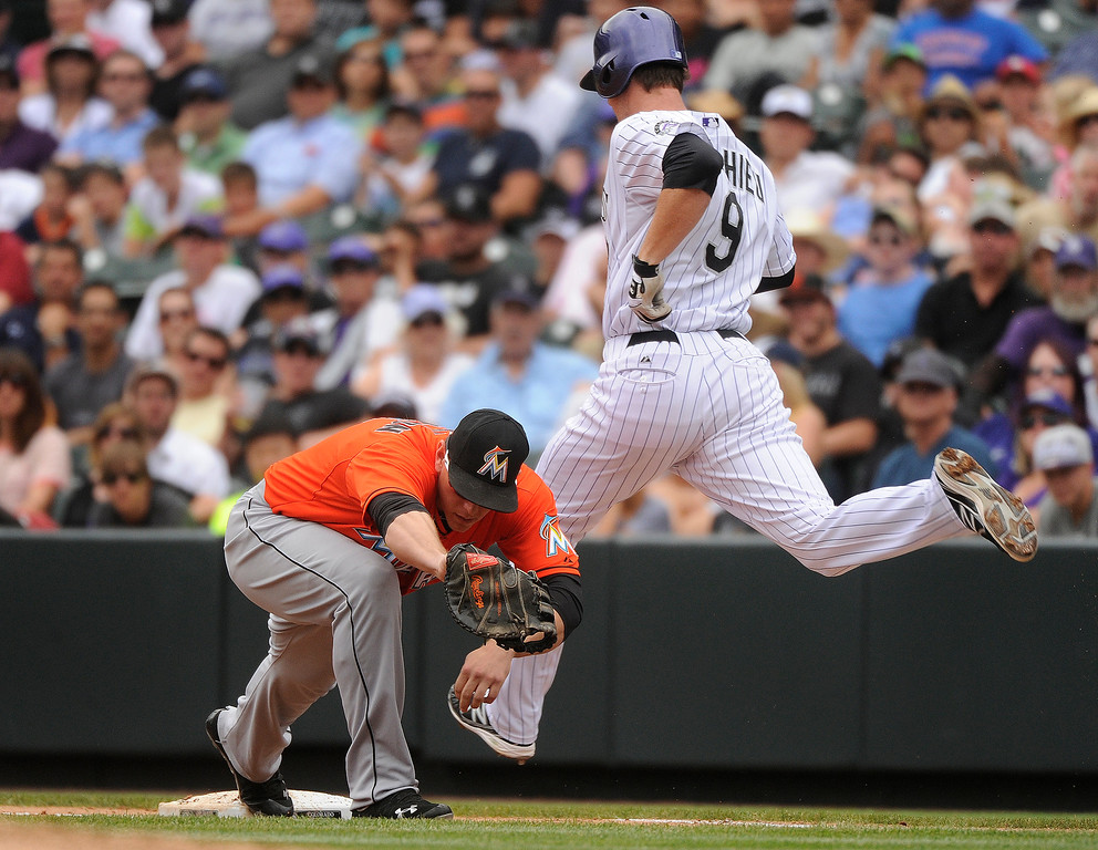 . Rockies\' DJ LeMahieu grounded out to end the third inning. The Colorado Rockies hosted the Miami Marlins at Coors Field Thursday afternoon, July 25, 2013. Photo By Karl Gehring/The Denver Post
