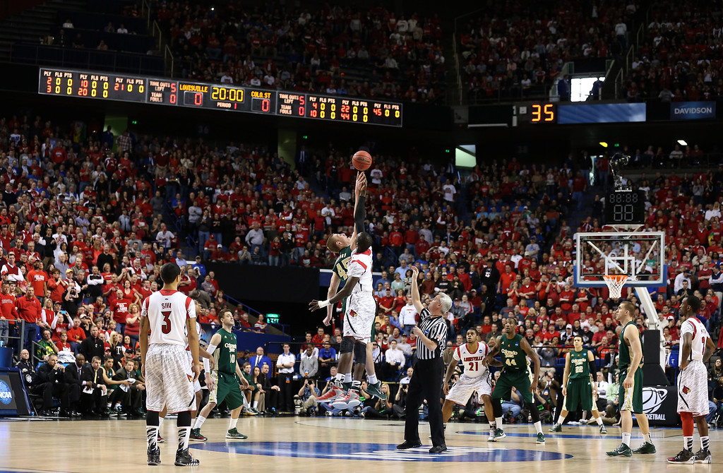 . LEXINGTON, KY - MARCH 23: Colton Iverson #45 of the Colorado State Rams and Gorgui Dieng #10 of the Louisville Cardinals go up for the opening tip during the third round of the 2013 NCAA Men\'s Basketball Tournament at Rupp Arena on March 23, 2013 in Lexington, Kentucky.  (Photo by Andy Lyons/Getty Images)
