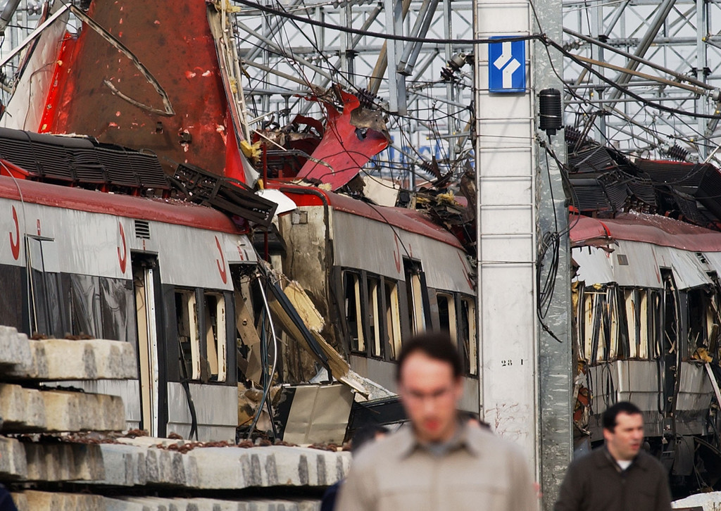 . The wreckage of a Spanish intercity train destroyed by an explosion lies on the track at Atocha railway station in Madrid Spain, Thursday, March 11, 2004. A series of explosions in the city killed at least 62 people and injured dozens. (AP Photo/Alvaro Hernandez)