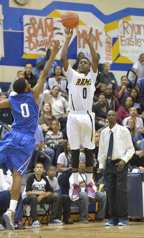 . LONG BEACH, CALIF. USA -- Millikan\'s Brian Chambers (0) takes a shot against Gahr\'s Darrell Harris (0) during their CIF-SS Divison 1-A playoff game in Long Beach on February 15, 2013. Millikan defeated Gahr, 74 to 64. Photo by Jeff Gritchen / Los Angeles Newspaper Group
