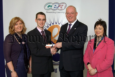 Padraig Mulholland a past pupil of St Coleman's College, Newry accepts a certificate from CCEA's Chief Executive Gavin Boyd to mark his achievement of joint first place in Art & Design in CCEA's summer 2006 A level examinations. Also pictured Art & Design teacher Eva Freeburn (left) and Head of Department Patricia Kelly (right).