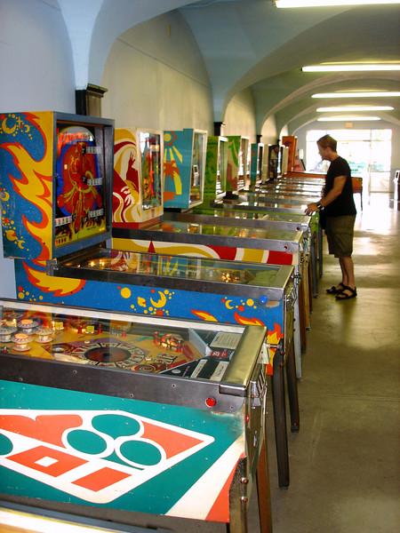 The line of pinball machines.