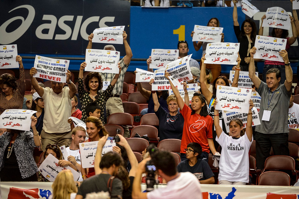 . Iranian wrestling fans show their support for olympic wrestling during the USA vs Russia vs Canada dual meet at the Sports Arena Sunday .  Iran was scheduled to participate at the meet but pulled out.  Photo by David Crane/Los Angeles Daily News.