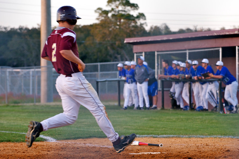 St. Augustine's Preston Kinlaw crosses home plate during Tuesday's baseball game against Bartram Trail High School.