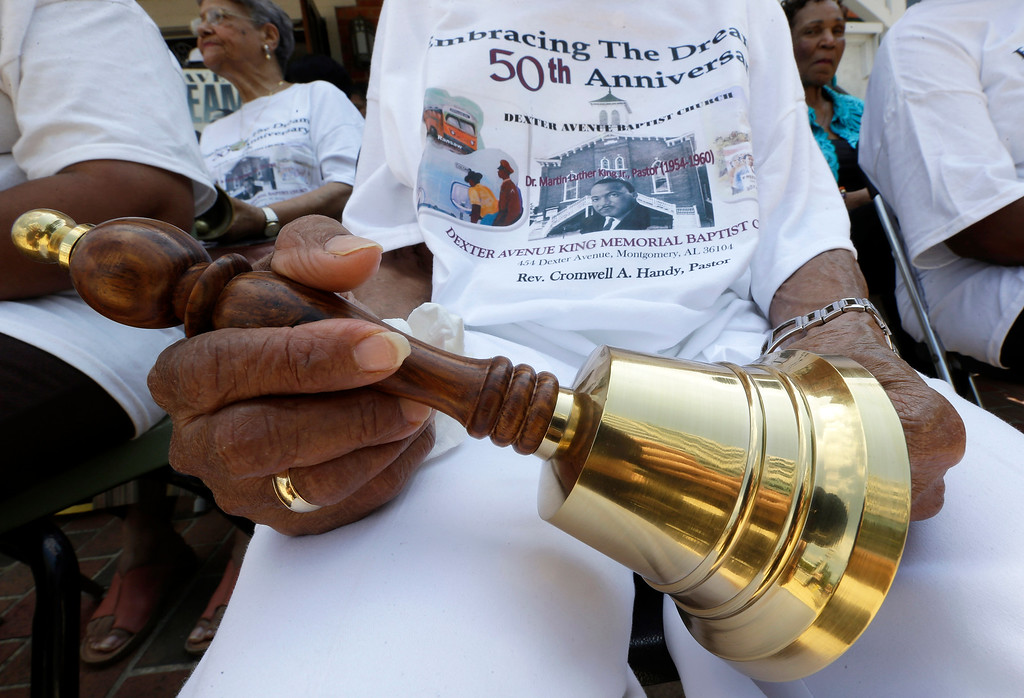 """. Jeanne Smiley of Montgomery, Ala., holds her bell during ceremonies honoring the 50th anniversary of the Martin Luther King Jr., \""""I Have a Dream\"""" speech in Montgomery, Ala., Wednesday, Aug. 28, 2013. The ceremony took place outside the Dexter Ave. King Memorial Baptist Church where King became pastor in 1954. Smiley said \""""Rev. King was a great man who helped make this country a better place to live.\"""" (AP Photo/Dave Martin)"""