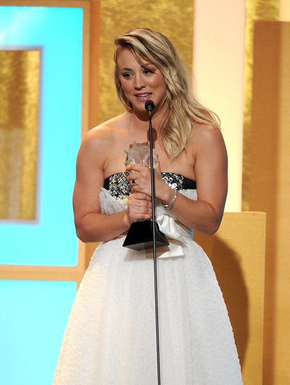 """. Kaley Cuoco accepts the award for best supporting actress in a comedy series for \""""The Big Bang Theory\"""" at the Critics\' Choice Television Awards in the Beverly Hilton Hotel on Monday, June 10, 2013, in Beverly Hills, Calif. (Photo by Frank Micelotta/Invision/AP)"""