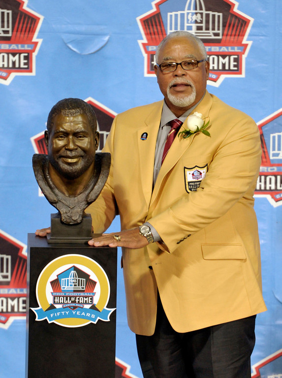 . Hall of Fame inductee Curley Culp poses with his bust during the 2013 Pro Football Hall of Fame Induction Ceremony Saturday, Aug. 3, 2013, in Canton, Ohio. (AP Photo/David Richard)