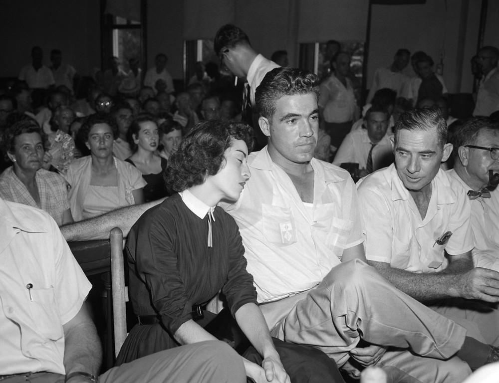 ". Carolyn Bryant rests her head on her husband Roy Bryant\'s shoulder after she testified in Emmett Till\'s murder court case in Sumner, Miss., Sept. 22. 1955.  Bryant is accused of murdering the 14-year-old Chicago native, who is black, for ""wolf-whistling\"" at his wife.  (AP Photo)"