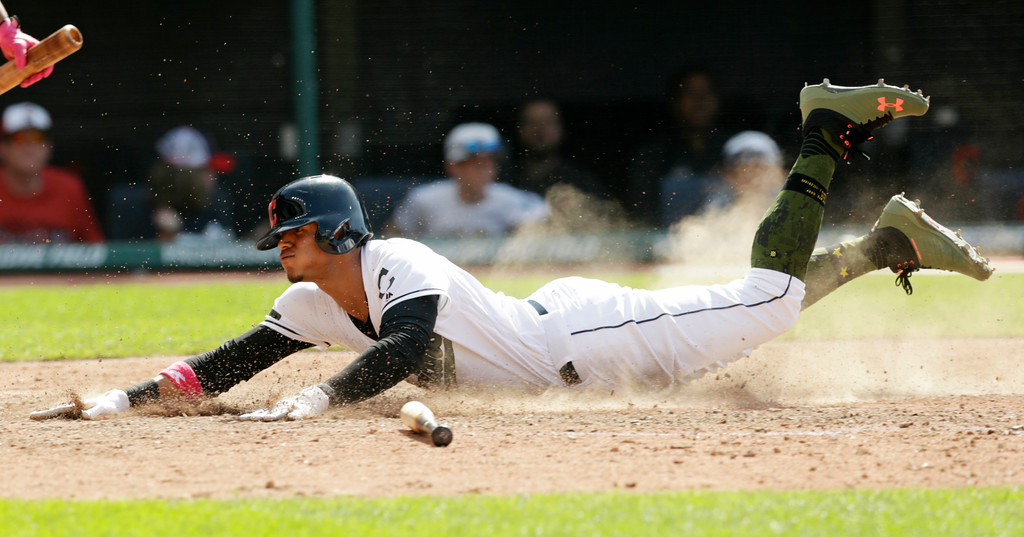 . Cleveland Indians\' Erik Gonzalez scores on an RBI-single hit by Michael Brantley in the ninth inning of a baseball game against the Houston Astros, Sunday, May 27, 2018, in Cleveland. (AP Photo/Tony Dejak)