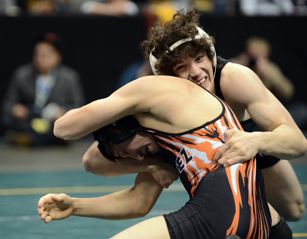. DENVER, CO. - FEBRUARY 23: Jace Lopez of Roosevelt High School, top, controls Ryan Daves of Montuzuma-Cortez High School during 4A 138 pound class State Championship at Pepsi Center February 23, 2013. Denver, Colorado. Lopez won the match.(Photo By Hyoung Chang/The Denver Post)