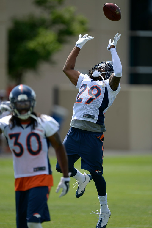 . Denver Broncos cornerback Bradley Roby (29) tips the ball in the air during tip  drills on day two of the Denver Broncos 2014 training camp July 25, 2014 at Dove Valley. (Photo by John Leyba/The Denver Post)