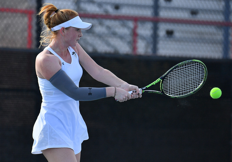 LAS VEGAS, NV - JANUARY 20:  Rebecca Keijzerwaard of the New Mexico State Aggies plays a backhand during her match against Pei-Hsuan (Patty) Kuo of the Weber State Wildcats at the Frank and Vicki Fertitta Tennis Complex in Las Vegas, Nevada. Kuo won the match 6-3, 7-6 (10-5),