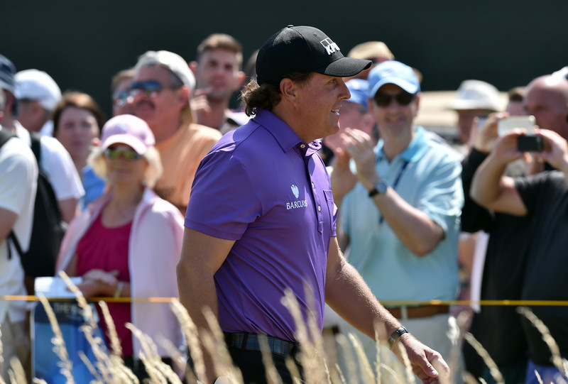 . US golfer Phil Mickelson leaves the 1st tee during his first round on the opening day of the 2014 British Open Golf Championship at Royal Liverpool Golf Course in Hoylake, north west England on July 17, 2014. (PAUL ELLIS/AFP/Getty Images)