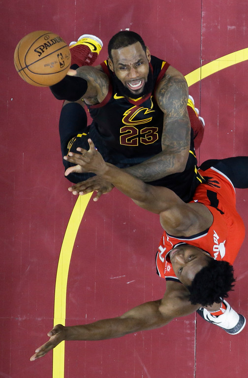 . Cleveland Cavaliers\' LeBron James shoots against Toronto Raptors\' OG Anunoby in the first half of Game 4 of an NBA basketball second-round playoff series, Monday, May 7, 2018, in Cleveland. (AP Photo/Tony Dejak)