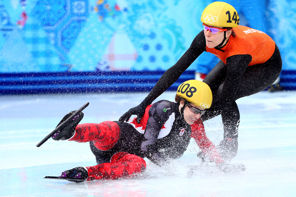 . Marianne St. Gelais of Canada falls while competing in the Short Track Ladies\' 1000m Heat at Iceberg Skating Palace on day 11 of the 2014 Sochi Winter Olympics on February 18, 2014 in Sochi, Russia.  (Photo by Paul Gilham/Getty Images)