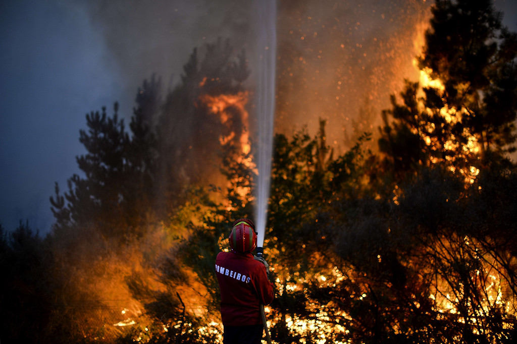 . A firefighter tries to extinguish a wildfire in Caramulo, central Portugal on August 29, 2013.   AFP PHOTO / PATRICIA DE MELO  MOREIRA/AFP/Getty Images