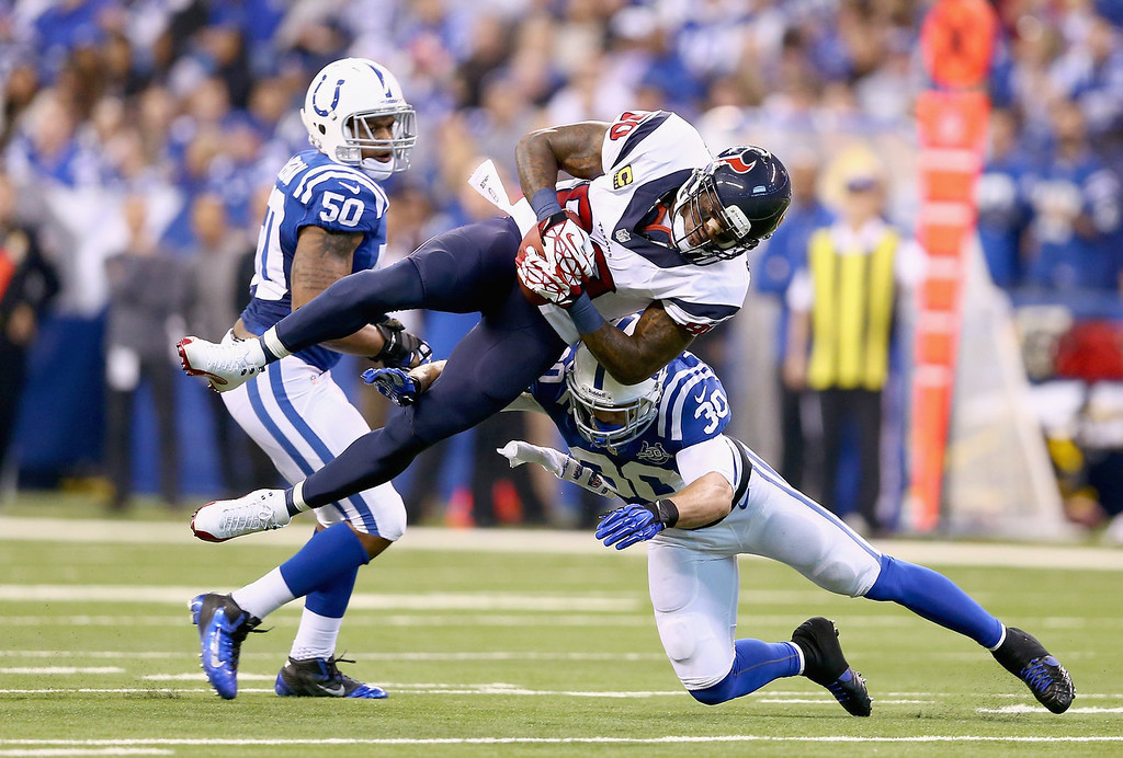 . Andre Johnson #80 Houston Texans is tackled by LaRon Landry #30  of the Indianapolis Colts during the NFL game at Lucas Oil Stadium on December 15, 2013 in Indianapolis, Indiana.  (Photo by Andy Lyons/Getty Images)