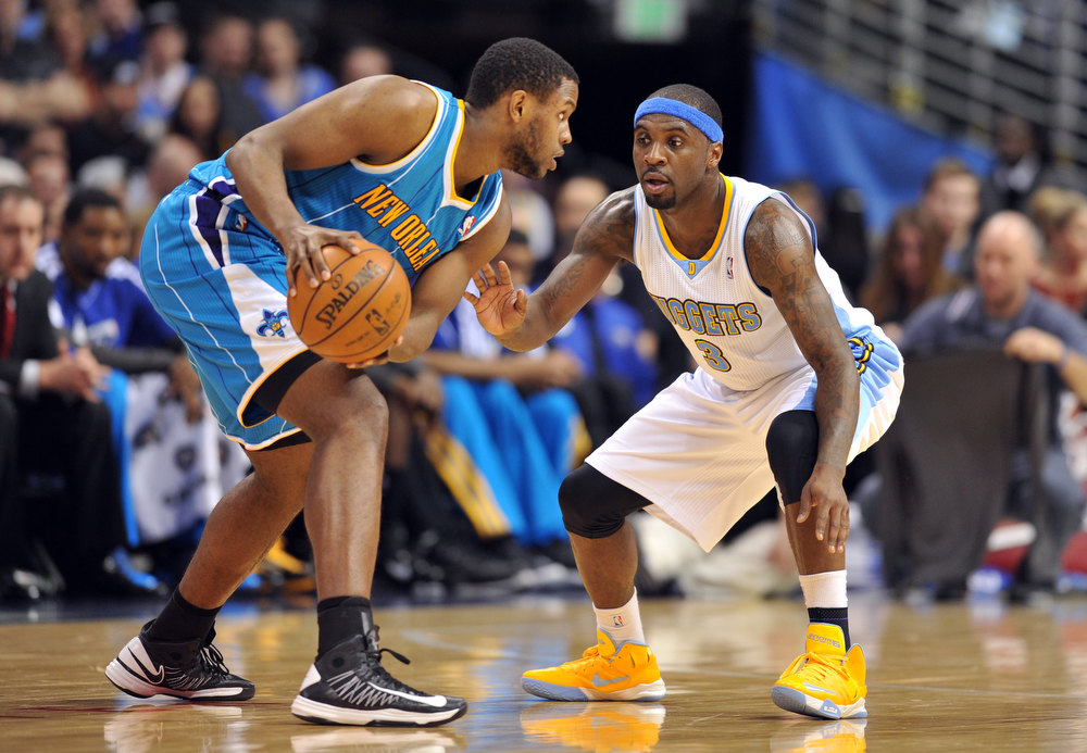 . DENVER, CO. - FEBRUARY 01: Ty Lawson of Denver Nuggets #3 prssures Darius Miller of New Orleans Hornets #2 in the 2nd half of the game on February 1, 2013 at the Pepsi Center in Denver, Colorado. Denver won 113-98. (Photo By Hyoung Chang/The Denver Post)