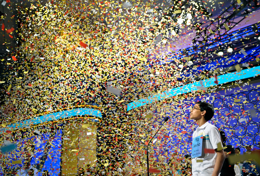 . Arvind Mahankali, 13, of Bayside Hills, N.Y. watches confetti fall after he won the Scripps National Spelling Bee in Oxon Hill, Md., Thursday, May 30, 2013. (AP Photo/Cliff Owen)
