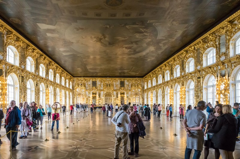 a gold encrusted ballroom at Catherine Palace in Russia.