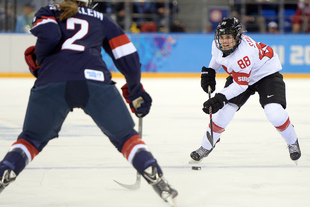 . Lee Stecklein (2) of the U.S.A. defends Phoebe Stanz (88) of the Switzerland during the first period of action at the Shayba Arena. Sochi 2014 Winter Olympics on Monday, February 10, 2014. (Photo by AAron Ontiveroz/The Denver Post)