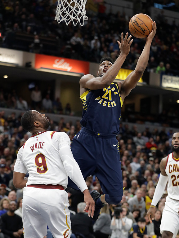 . Indiana Pacers\' Thaddeus Young shoots above Cleveland Cavaliers\' Dwyane Wade during the second half of an NBA basketball game Friday, Dec. 8, 2017, in Indianapolis. The Pacers won 106-102. (AP Photo/Darron Cummings)