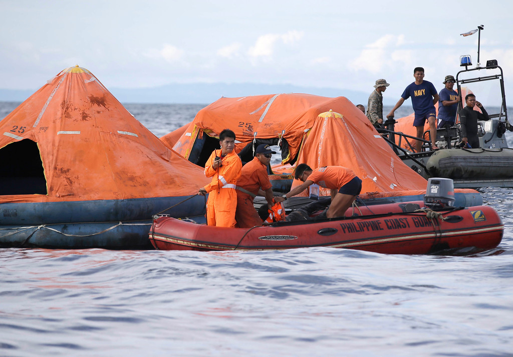 . A cluster of life rafts is seen floating near the cargo ship Sulpicio Express Siete Saturday Aug. 17, 2013, a day after the cargo ship collided with a passenger ferry off the waters of Talisay city, Cebu province in central Philippines. Divers combed through a sunken ferry Saturday to retrieve the bodies of more than 200 people still missing from an overnight collision with a cargo vessel near the central Philippine port of Cebu that sent passengers jumping into the ocean and leaving many others trapped. At least 28 were confirmed dead and hundreds rescued. (AP Photo/Bullit Marquez)