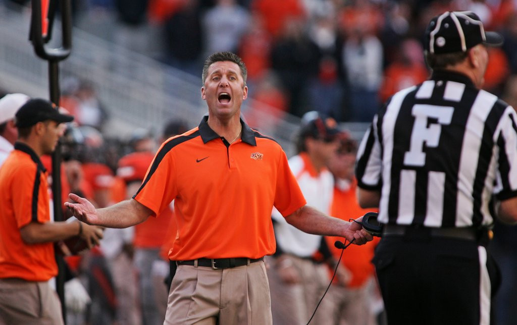 ". <p>2. OKLAHOMA STATE COWBOYS  <p>The head coaches never paid players a dime. That�s what assistant coaches are for. (unranked) <p><b><a href=\'http://sportsillustrated.cnn.com/college-football/news/20130910/oklahoma-state-part-1-money/\' target=""_blank\""> HUH?</a></b> <p>    (Brett Deering/Getty Images)"