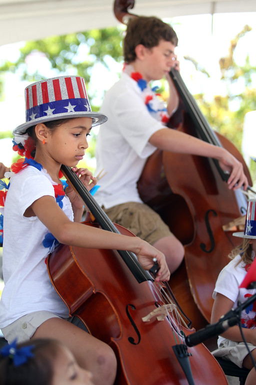 . Hasina Torres, 10, left, and John Woodword, 13, of Fresno\'s Simba School of Music, perform during the Independence Day celebration at Jack London Square in Oakland, Calif., on Thursday, July 4, 2013.  (Ray Chavez/Bay Area News Group)
