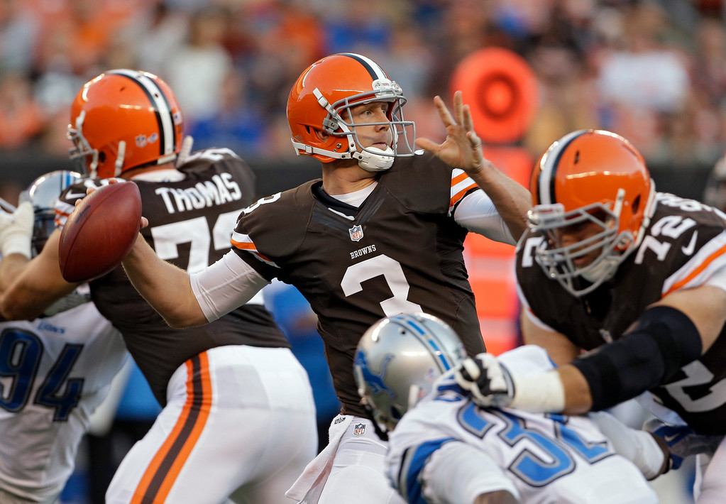. Cleveland Browns quarterback Brandon Weeden throws from the crowd during the first quarter of a preseason NFL football game against the Detroit Lions, Thursday, Aug. 15, 2013, in Cleveland. (AP Photo/Mark Duncan)