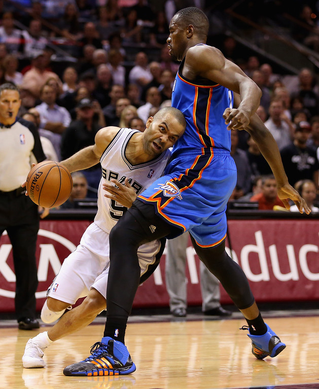 . Tony Parker #9 of the San Antonio Spurs tries to dribble past Serge Ibaka #9 of the Oklahoma City Thunder in the second quarter during Game Five of the Western Conference Finals of the 2014 NBA Playoffs at AT&T Center on May 29, 2014 in San Antonio, Texas.   (Photo by Ronald Martinez/Getty Images)