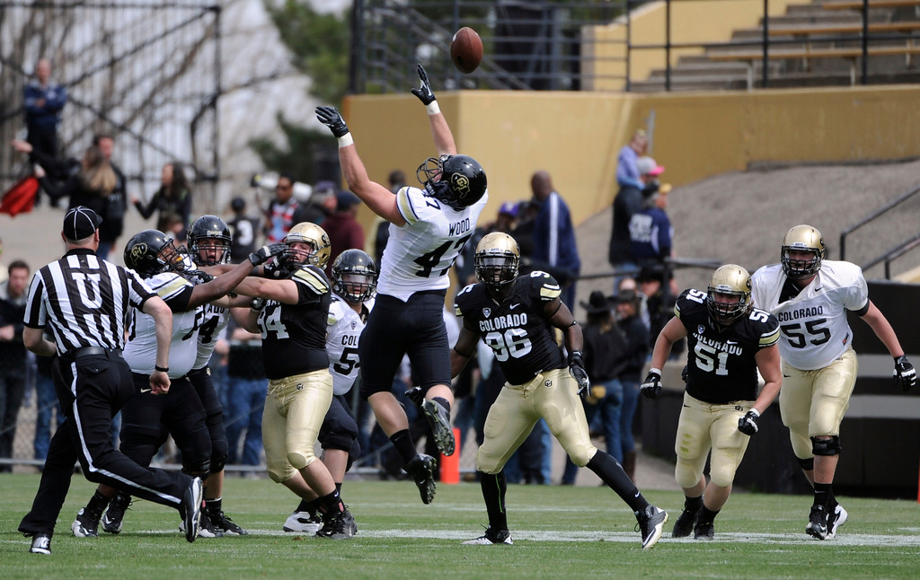 . BOULDER, CO.- APRIL13: Alex Wood leaps in to the air in an attempt to catch a Nick Hirschman pass.The University of Colorado football team hosts its spring football game at Folsom Field under the direction of new head coach Mike MacIntyre. (Photo By Kathryn Scott Osler/The Denver Post)