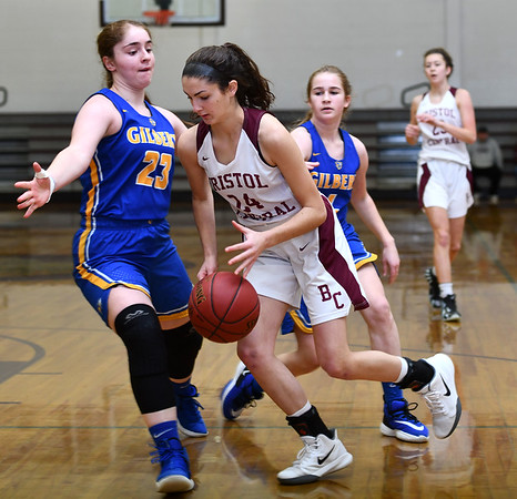 12/31/2019 MIke Orazzi | StaffrBristol Central's Sophia Torreso (24) and Gilbert's Ajla Gutic (23) during Tuesday's girls basketball game in Bristol. r