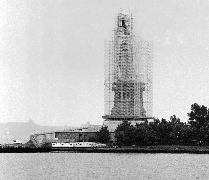 Statue of Liberty (August 1984) encased in scaffolding for renovation. (Note construction trailers on island)