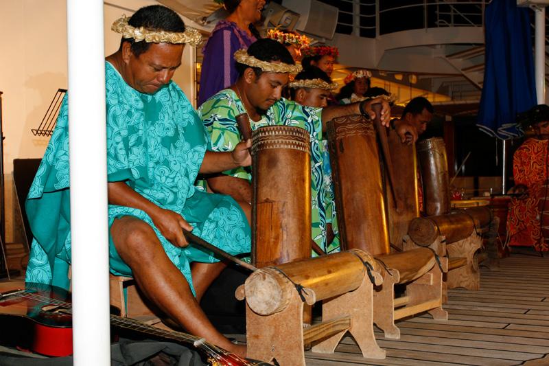 Local group come aboard to perform in Raiatea.