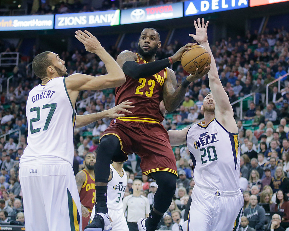. Cleveland Cavaliers forward LeBron James (23) passes the ball as Utah Jazz\'s Rudy Gobert (27) and Gordon Hayward (20) defend in the first half during an NBA basketball game Tuesday, Jan. 10, 2017, in Salt Lake City. (AP Photo/Rick Bowmer)
