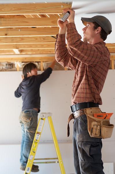 Tim Cook and Erka Erdenbayar work on renovations to Ms. Haley's house.