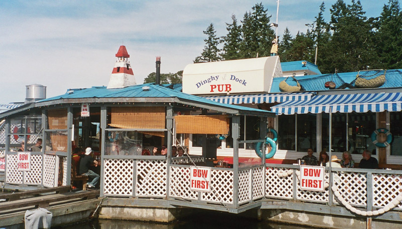 The Dinghy Dock Pub - Mike's waiving at us!