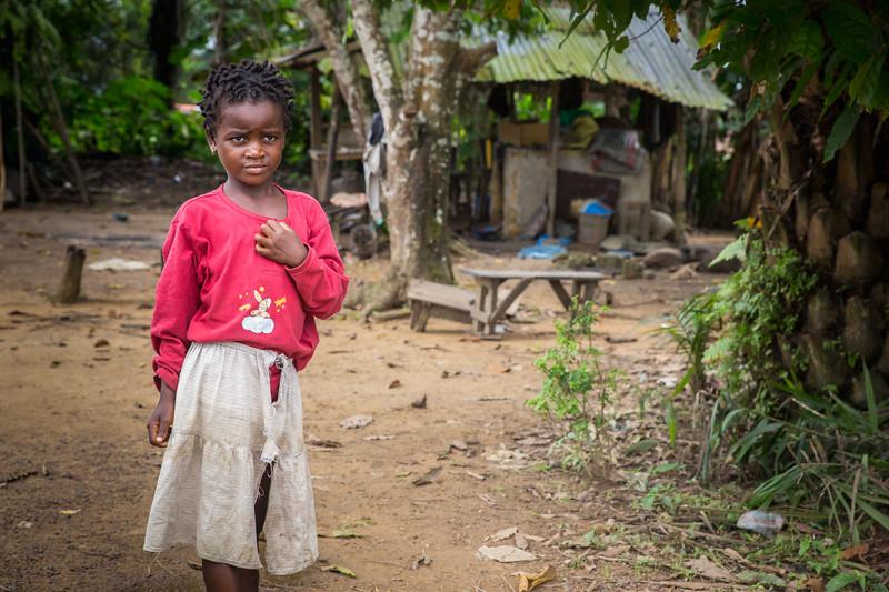 Monrovia, Liberia October 8, 2017 -  A young girl near her home.