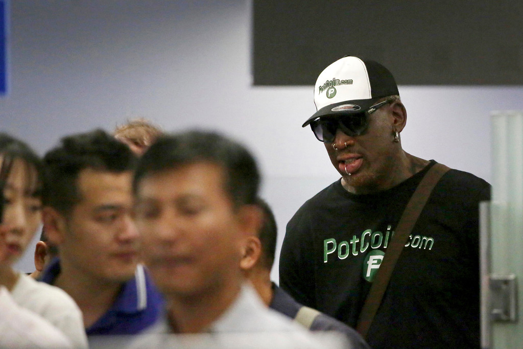 . Former NBA basketball star Dennis Rodman, right,  is seen in a security queue at Beijing\'s International Airport\'s terminal 2 on Tuesday, June 13, 2017, in Beijing, China. North Korea is expecting another visit by former NBA bad boy Rodman on Tuesday in what would be his first to the country since President Donald Trump took office. (AP Photo/Wong Maye-E)