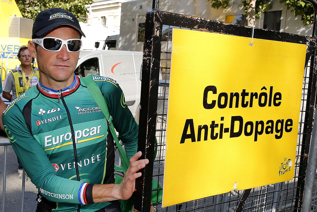 . France\'s Thomas Voeckler leaves the anti-doping control zone at the end of the 168 km sixteenth stage of the 100th edition of the Tour de France cycling race on July 16, 2013 between Vaison-la-Romaine and Gap, southeastern France.   PASCAL GUYOT/AFP/Getty Images