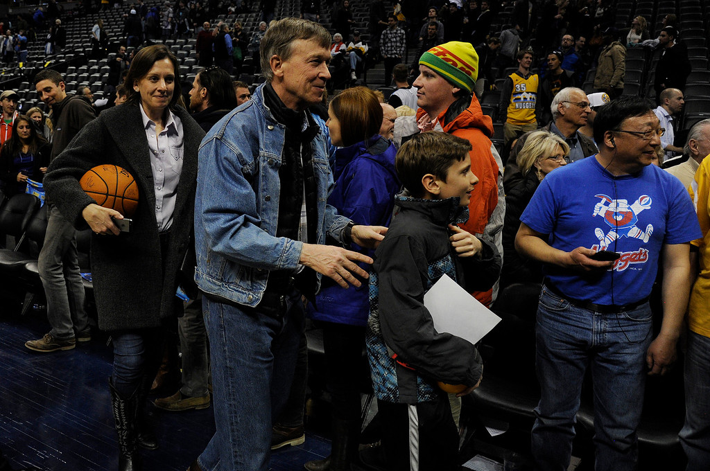 . DENVER, CO - MARCH 03: Gov. John Hickenlooper and company watch as the Denver Nuggets leave the court after the second half of a 106-95 Nuggets win over the Milwaukee Bucks. The Denver Nuggets hosted the Milwaukee Bucks at the Pepsi Center on Tuesday, March 3, 2015. (Photo by AAron Ontiveroz/The Denver Post)