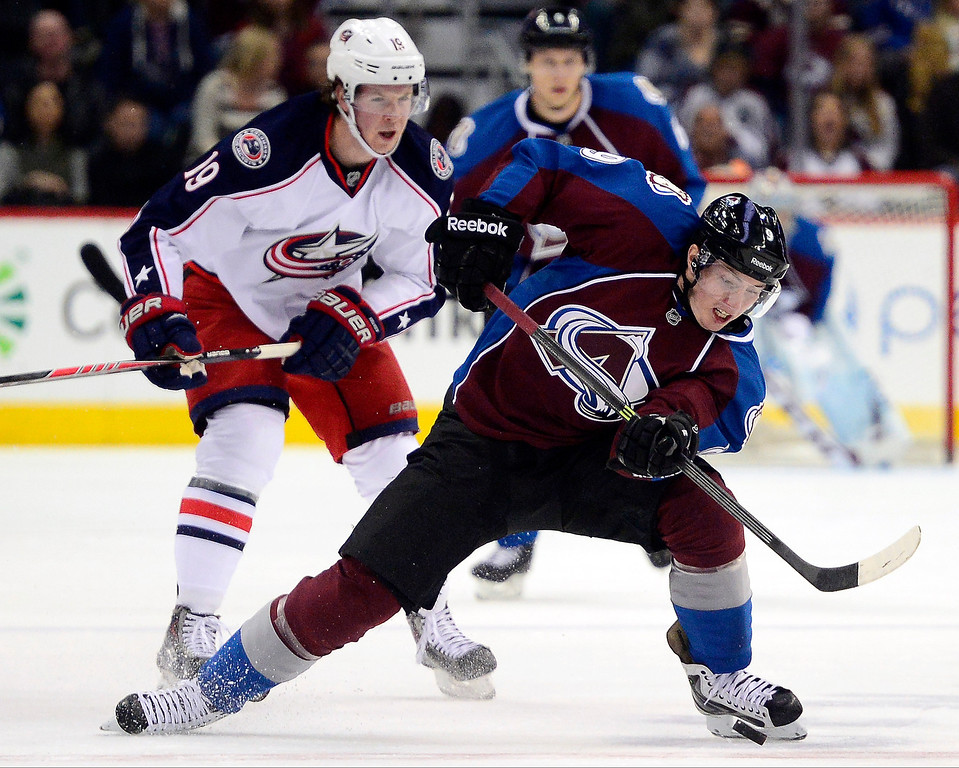 . Matt Duchene (9) of the Colorado Avalanche keeps his balance after taking contact from Ryan Johansen (19) of the Columbus Blue Jackets during the first period. The Colorado Avalanche hosted the Columbus Blue Jackets at the Pepsi Center on Tuesday, December 31, 2013. (Photo by AAron Ontiveroz/The Denver Post)
